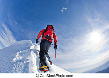 Climbing - Climber on a snowy ridge, italian alps, Europe...