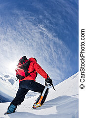 Mountain climber - Mountaineer reaching the top of a...
