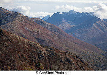 Alpine Mountains in Fall - A series of rugged peaks covered...