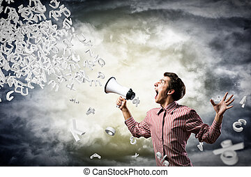 man yells into a megaphone - man shouts through a megaphone....