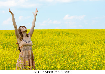 Young woman at canola field - Young woman having fun at...