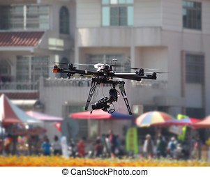 Unmanned Aerial Vehicle with a Digital Camera - A UAV or...