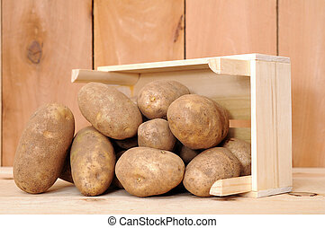 russet potato with crateon wooden shelf