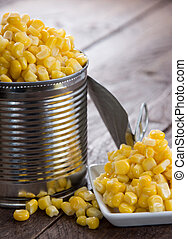 Corn - Canned Corn on a wooden background