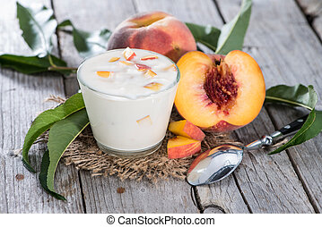 Portion of Peach Yogurt on wooden background