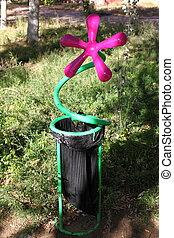 Trash disposal bin decorated