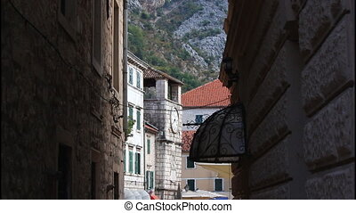 A narrow street, city walls - A narrow street in Kotor,...