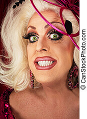 Smiling Woman with Long Eyelashes - Smiling blond drag queen...