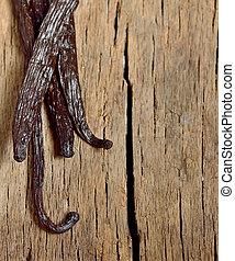 vanilla beans - Bourbon vanilla beans isolated on old wooden...