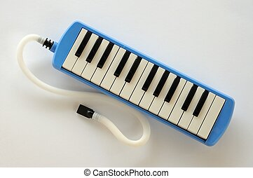 Pianica blow-organ. - Blue and white Pianica blow-organ.