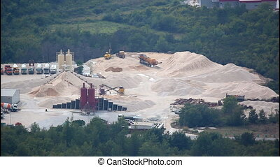 Construction site, piles of sand, silos