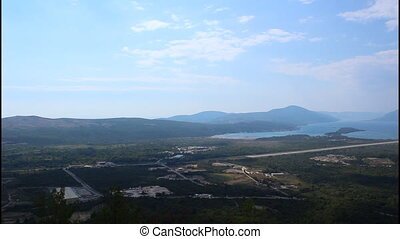 Airport, pan right, wide shot - Panoramic view of Tivat bay,...