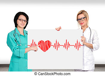 heartbeat - two female doctor holding placard with heartbeat