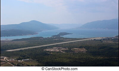 Airport runway, pan right - Wide shot Tivat bay, airport...