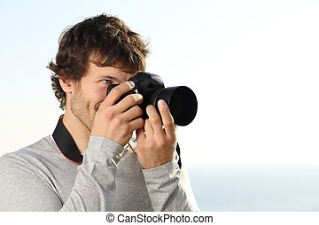Attractive photograph photographing with a slr camera...