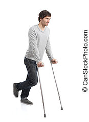 Rehabilitation of an adult man walking with crutches...