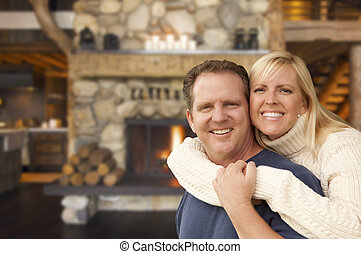 Affectionate Couple at Rustic Fireplace in Log Cabin - Happy...