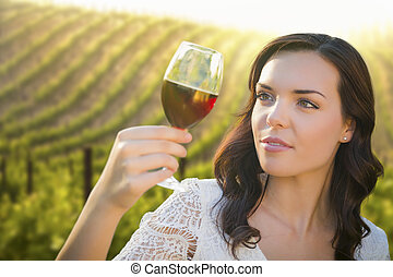 Young Adult Woman Enjoying A Glass of Wine in Vineyard -...