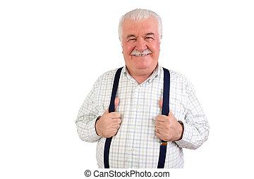 Confident senior man holding his suspenders - Confident...