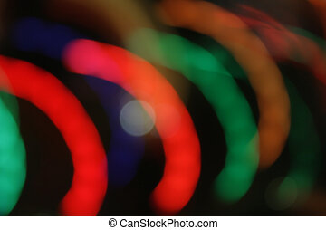 Lights blur motion in semi-circles on black