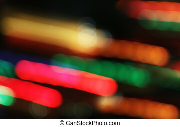 Lights blur in motion on black - Colorful lights blur in...