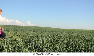 hapyy woman corn field - continuous field of rye away goes a...