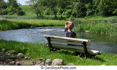 woman admire nature - woman sitting on the bench unbind long...