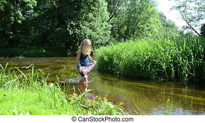 women in stream - women wade in the stream corrects blonde...
