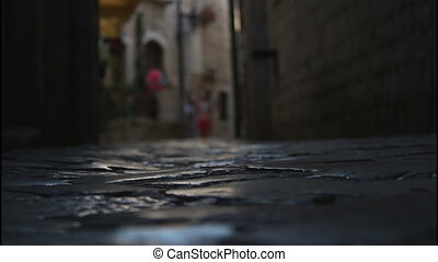 The dark narrow streets, stone pavement
