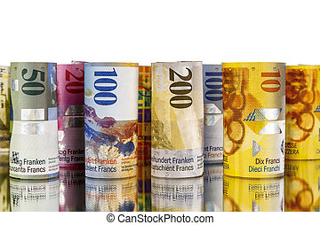 Swiss franc, banknotes rolled up in rolls