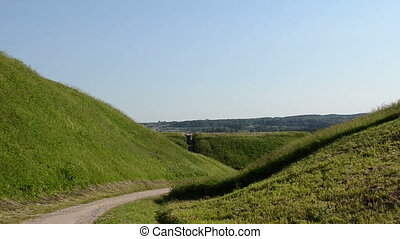 people tourist hill mound - People tourist climb on mound...