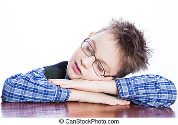 Sleeping boy on the table , isolated on white.