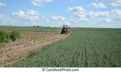 tractor plough plants - Farmer with small rural tractor...