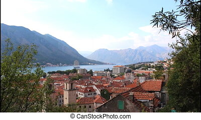 Panoramic view of Kotor, roofs, tilt up to the sky