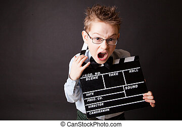 Little boy holding clapper board in hands Cinema concept
