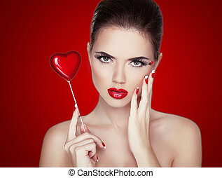 Beauty Woman Portrait. Professional Makeup for Brunette with Red Lipstick.  Beautiful Fashion Model Girl. Perfect Skin. Make up. Isolated on Red Background.
