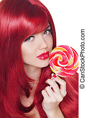 Coloring Hairstyle. Beauty Girl Portrait holding Colorful lollipop. Fashion makeup. Isolated on white background. Colourful Studio Shot of Funny Woman.