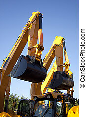 Pair Of Excavators Arms Next to Each Other