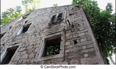 Abandoned house - Old abandoned stone house, tilt