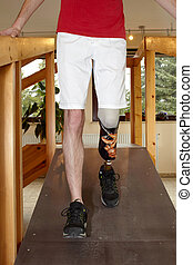Male prosthesis wearer training to walk - Male prosthesis...