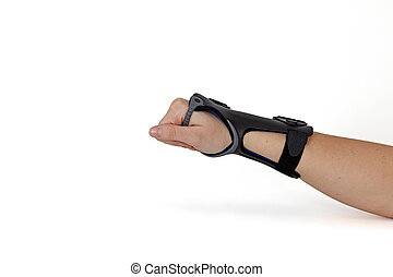 Carpal Tunnel Syndrome Brace - Womans hand isolated on white...