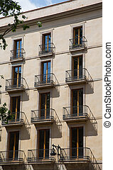 Brown Plaster Hotel with Iron Balconies