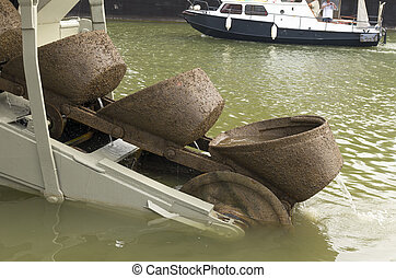 dredge boat - scoops at the end of a dredge boat