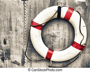 life buoy attached to a metal wall on a ship