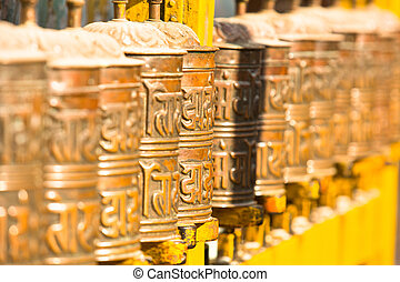 Spinning Tibetan Buddhist prayer wheels at Boudhanath stupa...