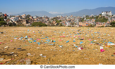 Debris on the field of view of panorama Kathmandu in the background. Environmental problems.