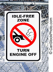 Idle-Free Zone, Turn Engine Off Sign on a Fence