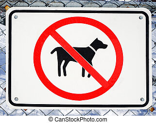No Dogs Allowed Sign - No dogs allowed sign on a fence