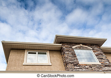 Roofline of a House - Roofline showing windows, brick...