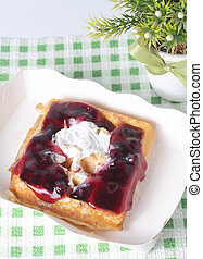 Bread topped with blue berries